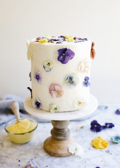 This lavender cake has a creamy lemon curd filling and a whipped American vanilla buttercream. The cake is a tall cake that serves a crowd! Edible Flowers Cake, Flower Cakes, Flowers On Cake, Sugar Flowers, Lavender Cake, Lemon Curd Filling, Wood Spoon, Rustic Cake, Vanilla Buttercream