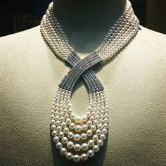 Pure luxury: a couture inspired necklace of mezmerising beauty featuring five strands of pearls delicately forming the symbol of infinity, ingeniously connected by five rows entirely studded with diamonds from the both sides. Signature style by @official_mikimoto Original photo by @couturenotebook #mikimoto #pearls #statementnecklace #signaturestyle #hautejoaillerie #savoirfaire #oneofakind #daringbeauty #timeless #realmofjewellery