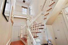 Photos via Realtor We love this Algiers Point Victorian camelback because it's a lovely conversion from a double to a single; there's a...