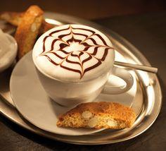 Comemorando o Dia Nacional do Café com um cappuccino (pena que o meu não é tão lindo como o da foto).