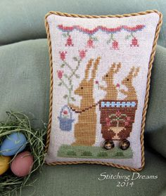 Bunnies cross stitched tiny pillow