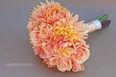 love the shape and texture of this bouquet! peach roses and dahlias.