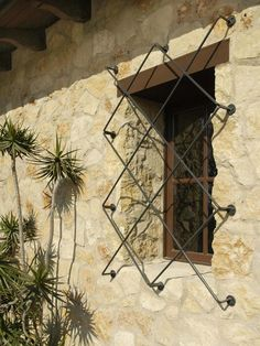 Exterior Window Details: Windows showcase the rubble stone and thick plaster walls of this Spanish-inspired home. From HGTVRemodels.com