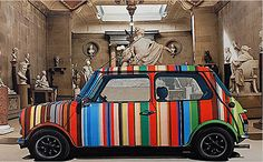 Mini design by Paul Smith - stripy orange box
