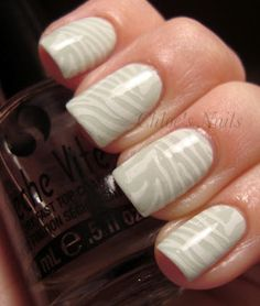 Essie Absolutely Shore with a white Konad zebra stamp. From Chloe's Nails.