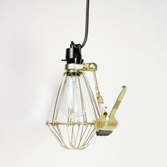 Clip cage lamp {note from htf: main image looks blurry} Pendant Lamp, Pendant Lighting, Clamp Lamp, Wire Clamp, Cage Light, Light Clips, Luminaire Design, Household Items, Ceiling Lights
