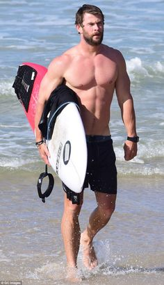 Sun, Sea and Surf! Chris Hemsworth flashed muscular physique as he left the surf in Byron Bay on Thursday, carrying his board back to his car