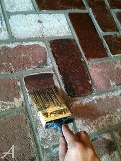 DIY- How to update your brick (fireplace, patio, etc.) Don't paint it but stain it!