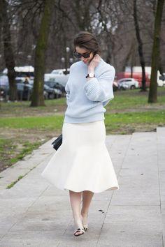 Beautiful autumn street style: white skirt blue top