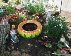 old tire - free - outdoor paints from JoAnn's - cheap.  Sunflower planter in my garden - fun!
