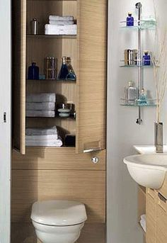 small bathroom design with wall shelves