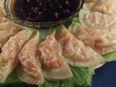 SHRIMP POT STICKERS (DUMPLINGS) PF CHANGE. Tender shrimp, carrots, ginger, green onion and garlic mixture steamed in wonton wrappers. Served with dipping sauce makes this a great appetizer. This is my rendition of the famous PF Chang's Shrimp Dumplings.
