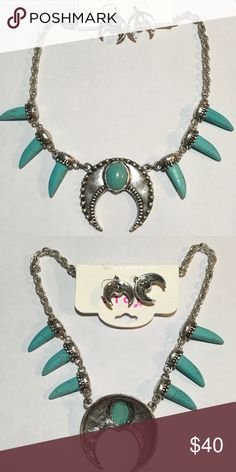 """Satin Silver Turquoise Horn Horseshoe Necklace set Beautiful Satin Silver Turquoise Magnesite Horn Horseshoe Necklace and Earring Set. 20"""" with 3"""" extension. Pendant is 2.25 """" x 2.25"""". Horns are 1.25"""". Very Trendy Set. Boutique Jewelry Necklaces"""