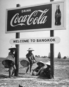 """:: โต๊ะสวนฯ Billboard advertising Coca Cola at the outskirts of Bangkok with welcoming sign beneath saying """"Welcome to Bangkok"""". Location: Bangkok, Thailand  Date taken: March 29, 1950  Photographer: Dmitri Kessel"""