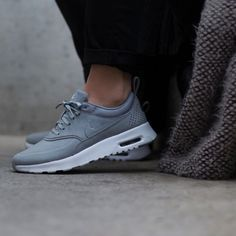 Nike Air Max Thea Grey Premium Leather Sneakers •The Nike Air Max Thea Women's Shoe is equipped with premium lightweight cushioning and a sleek, low-cut profile for lasting comfort and understated style. Color is Stealth Grey. •Women's size 8, true to size. •New in box (no lid). •NO TRADES/PAYPAL/MERC/VINTED/NONSENSE Nike Shoes Sneakers