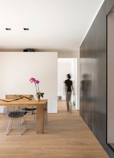 e15 dining table LONDON by Philipp Mainzer featured in apartment with free-standing white walls and wooden floor. / www.e15.com #solidwood #oak