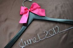 This is such a cute gift idea!  Custom Made Wood Wedding Hanger by allthingshandkrafted on Etsy, $8.75