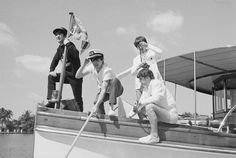 """2-14-1964: After a pool Life Magazine shoot, the lads were whisked off for an afternoon's cruise aboard the Southern Trail, a 93-foot yacht with a full crew, owned by the sofa-bed magnate Bernard Castro. By midday the tropical sun had broken through, allowing them to take advantage of the great day. They went for a lazy group swim in the ocean. Later, Paul sat behind the yacht's piano and reportedly banged out a few lines of their next single, """"Can't Buy Me Love."""""""