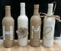 Hand wrapped with jute twine and cream colored yarn. Features the word HOME wrote in lace, buttons, jute twine and burlap. Approx 12 high, 4 bottles in total. These sweet bottles would make a great addition to anyones home decor. A lovely wedding or housewarming gift! The neutral