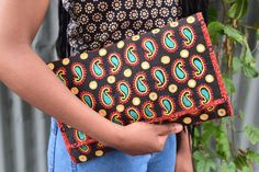 Black red yellow green paisley handmade clutch by SaheliDesigns on Etsy https://www.etsy.com/au/listing/271700640/black-red-yellow-green-paisley-handmade