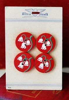 so cute! Vintage red, white and green floral buttons on original card.