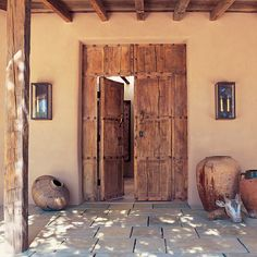 Love the door and the beams even if they're not traditional adobe features.