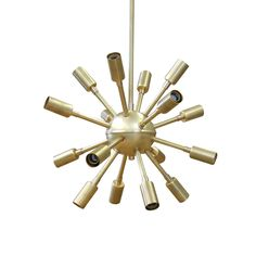 Brass Mid Century Modern Chandelier - Searching high and low for an amazing light fixture to replace that boring ceiling fan in your trendy tots #nursery?? Look no further because we have this brass Sputnik (high on #design, low on price) in the #PNShop!