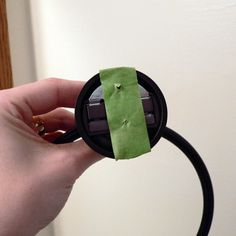 poke holes through tape to match the holes in the hardware & stick to wall where you want hold for fixture.