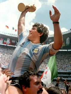 "Diego Maradona celebrates after securing an Argentina win in the World Cup. Maradona scored two goals in the game—one of which would later be called ""the goal of the century""."