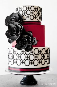 red white and black wedding cake with black rice paper flowers