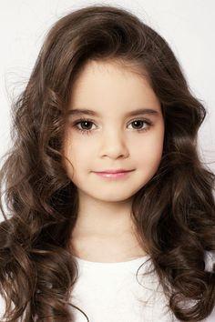 Elizabeth Zarova  Brown eyes  Brown hair long 6 years old Model kids Russia