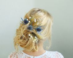 Lovely messy Bridal Up Do with natural blue thistle and Baby's Breath flowers by our team.