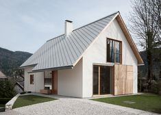 Alpine home couples traditional form with modern materials
