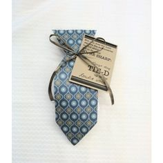 """Missionary Gift Tie - a paper tie is attached to a bag full of tootsie rolls.  Attached is a message to your missionary to stay """"tied"""" up in the Lord's work.  Available to buy in Lehi, Utah.  We also ship!"""
