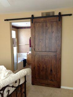 Distressed Knotty Alder Sliding Barn Door  LONGER TRACK, WIDER DOOR, ONE DOOR PANEL ACCOMODATES TWO OPENINGS