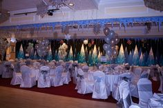 St Pierre Park, decorated for a Winter Wonderland themed Christmas party. Chair Covers, Winter Wonderland, Ideas Para, Wedding Reception, Chandelier, Guernsey, Ceiling Lights, Table Decorations, Party