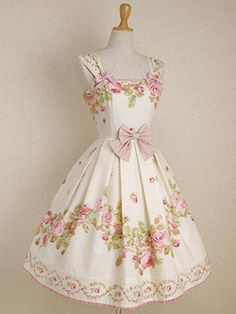 I'm in love with this lolita dress! The colors and shape and floral patterns are all so lovely, and yay for bows <3 !