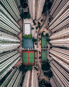 In the middle f sky scrapers there are a bunch of tennis courts. Look surreal.