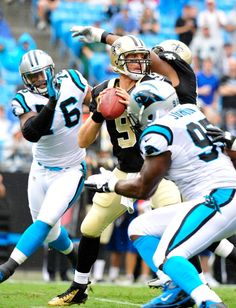 : Greg Hardy #76 and Charles Johnson #95 of the Carolina Panthers pressure quarterback Drew Brees #9 of the New Orleans Saints during play at Bank of America Stadium on September 16, 2012 in Charlotte, North Carolina. (Photo by Grant Halverson/Getty Images)