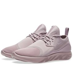 low priced a2c9a bf28e Nike s Women s LunarCharge Essential sneakers combine influential elements  from some of this brand s most popular styles