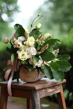bridal bouquet with cream lisianthius, chamomile, White Majolica spray roses, tuberose, peach