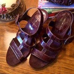 """Brown Bandolino Leather Sandals These are a comfortable go-with-anything kind of sandal. Dark brown croc embossed leather upper with a T-strap style and large side buckle. 3"""" heel. 1/2 platform. Sueded footbed. Never worn. Beautiful like new condition. Size 8. Bandolino Shoes Sandals"""