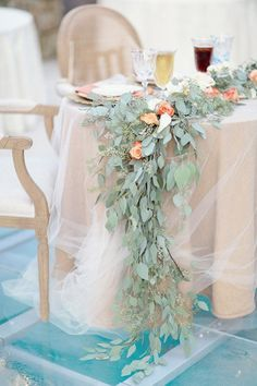 rose and eucalyptus garland on tulle covered sweetheart table