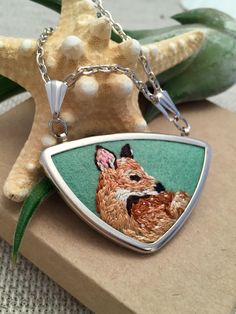 I love this necklace! It's a one of a kind, hand embroidered fawn pendant. It would make the perfect gift for an animal lover or nature lover. (Embroidery Jewelry, Etsy Necklace, Gift for wife, gift for mom, gift for friend, deer necklace, fawn necklace, deer jewelry, fawn jewelry, fawn gift, deer gift, gift idea, Christmas gift idea)