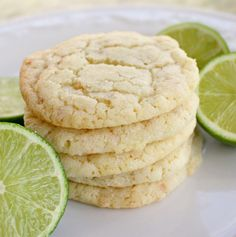 Chewy Coconut Lime Cookies  2 3/4 cups all-purpose flour     1 teaspoon baking soda  ½ teaspoon baking powder  ½ teaspoon salt  1 cup butter, softened  1 ½ cups white sugar  1 egg  ½ teaspoon vanilla extract  zest of one large lime, finely minced  3 tbsp lime juice  ½ cup unsweetened toasted coconut  ½ cup sugar for rolling cookies
