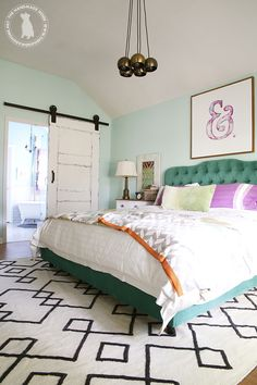 The turquoise bed, the watercolor ampersand, and the barn door.  Love!