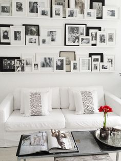 I like this idea... you can add lots of framed photos, move them around  & switch them out without a lot of commitment (no holes in the wall!) **Like this pin?** Come check out the rest of my boards & follow me! :)