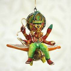 Ironically, this little flying Hindu deity, Ganesha, would make the perfect ornament for your Christmas tree ;)