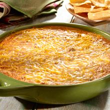 Kick off Sunday's game with this delicious, crowd-friendly warm refried bean dip. The dip emerges from the oven bubbly and ready to devour –so addictive you might need to make two!