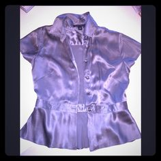 Soft gray silk top Beautiful 100% silk top, covered buttons and soft peplum. Super cute with gray jeans and black pumps. Banana Republic Tops Blouses